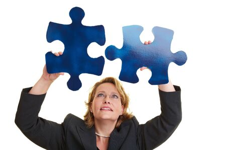 two pieces: Business woman holding two blue jigsaw pieces