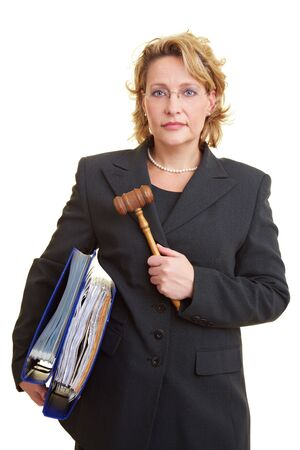 female judge: Female judge carrying files and wooden hammer