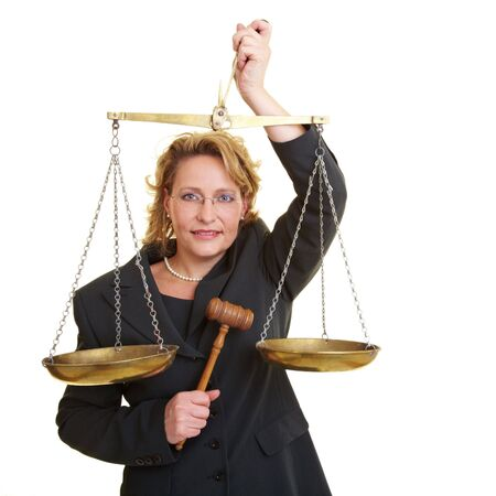 appraise: Woman in jacket with wooden hammer and scales Stock Photo