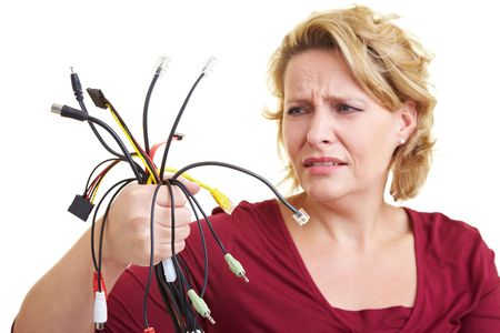 computer cable: Woman looking puzzled at many colorful cables