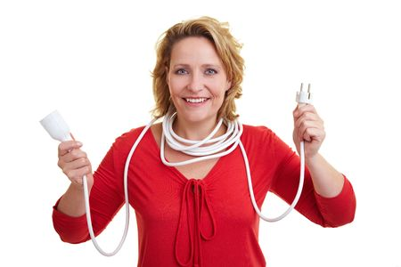 Woman holding an extension cord with both hands photo