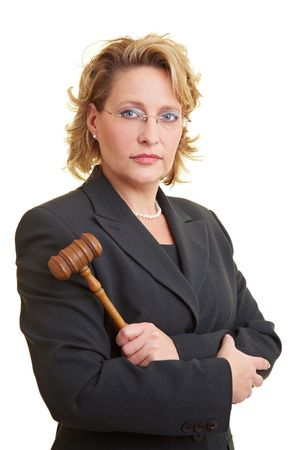 verdicts: Female judge in jacket posing with hammer