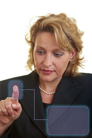Business woman pressing her finger on a digital information sensor Stock Photo - 6219630