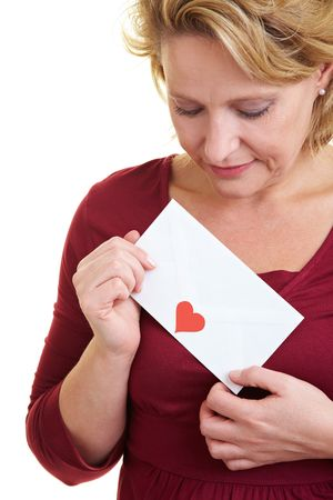 Happy woman holding a love letter in her hand photo