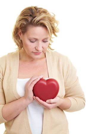 Woman holding a red heart at her bossom Stock Photo - 6219728
