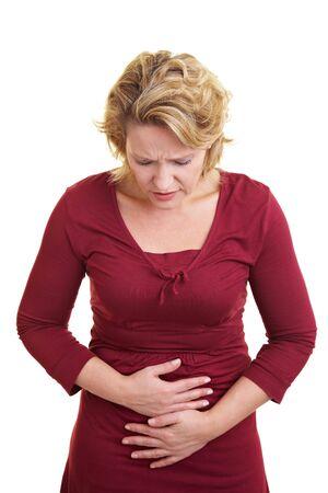 convulsión: Mujer sosteniendo su est�mago con las manos