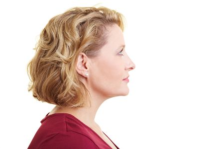 woman face profile: Profile view of a woman looking rightward Stock Photo