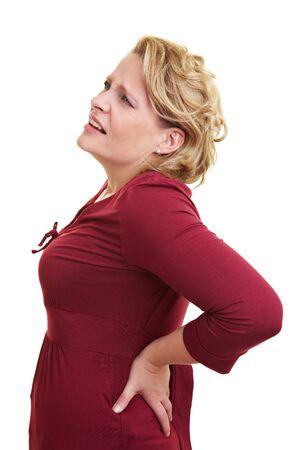 personnes de dos: Femme maintenant ses mains sur son dos bless�s Banque d'images