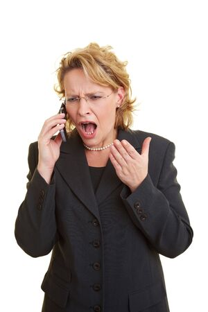 Angry business woman screaming in her cell phone Stock Photo - 6219744