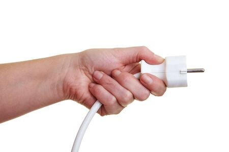 Hand holding a power plug to the right photo