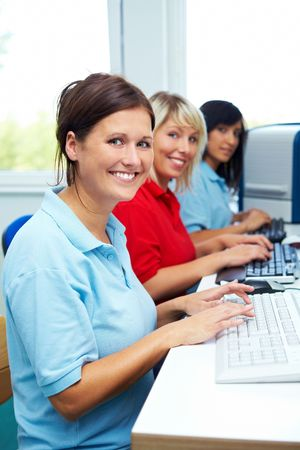industriousness: Female workers sitting on computer work stations
