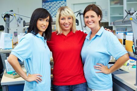 Three dental technicians in a dental laboratory Stock Photo - 6358185