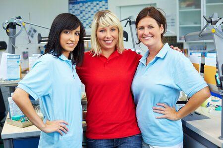Three dental technicians in a dental laboratory Stock Photo - 6358185