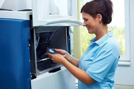 zircon: Dental technician with zircon material on a CAM