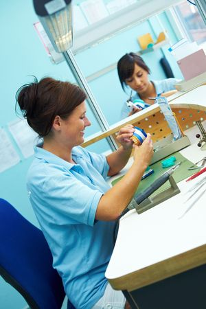 Two dental technicians working in a dental laboratory Stock Photo - 6358065
