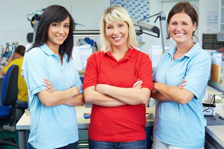 Three dental technicians in a dental laboratory