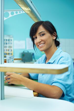 Young female turk working as dental technician photo