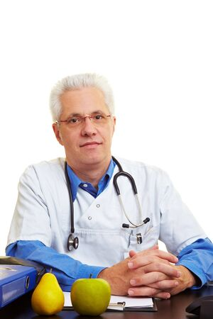 Doctor at his desk is listening carefully Stock Photo - 6357966