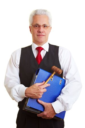 judge hammer: Elderly judge carrying files and a gavel