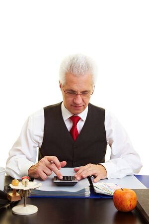 Senior citizen sitting at desk and calculating his pension Stock Photo - 6358127