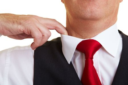 Businessman lifting the collar with his finger Stock Photo - 6358119