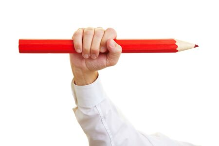 Hand holding a big red oversized pencil Stock Photo - 6357967