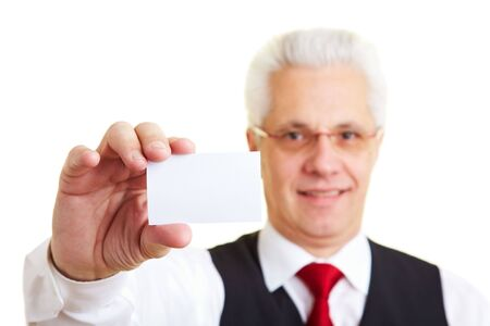 An elderly businessman holding his business card Stock Photo - 6358195