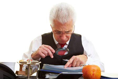 Senior citizen reading the fine print in a contract