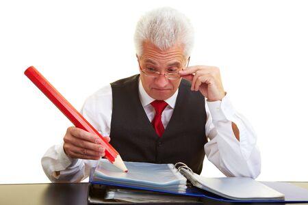 przewymiarowany: Menedżer pisania zbyt duży ołówkiem czerwony  Zdjęcie Seryjne
