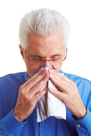 Senior citizen blowing his nose with an handkerchief Stock Photo - 6358473