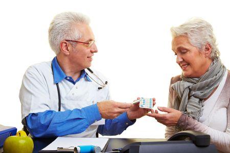 A doctor giving senior citizen medikation Stock Photo - 6375746