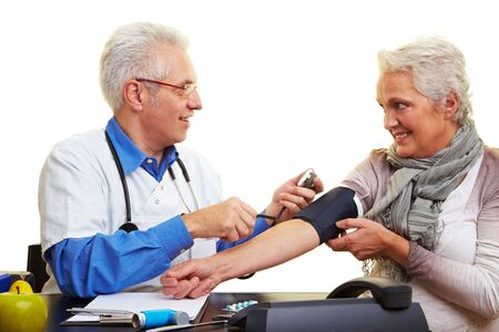 Doctor measuring blood pressure at his patient Stock Photo - 6375743