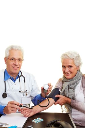 Doctor measuring the blood pressure for his patient Stock Photo - 6375755