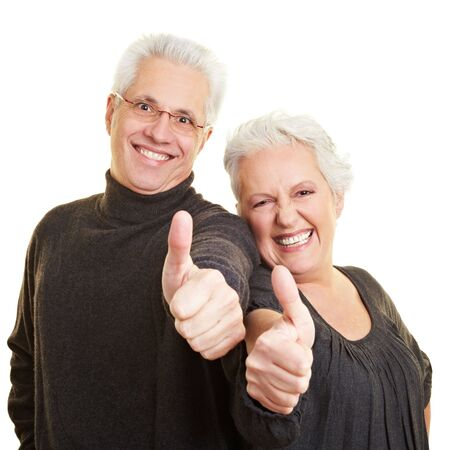 senior citizens: Two happy senior citizens holding their thumbs up Stock Photo