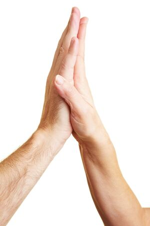 high five: Two hands giving each other a High Five Stock Photo