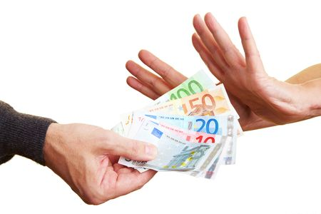 bribery: Two hands rejecting Euro banknotes