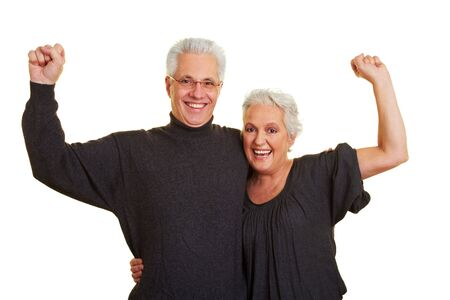Two happy senior citizens clenching their fists photo