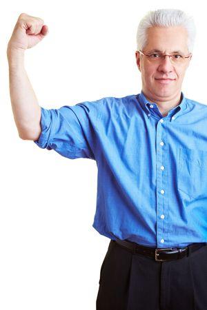 arm muscles: Senior citizen flexing his upper arm muscles