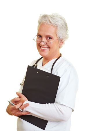 a round of inspection: A senior female doctor holding a clipboard