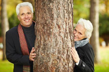 Happy senior couple in an autumn forest photo