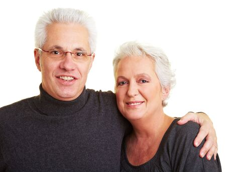 Happy senior citizen couple with grey hair embracing photo