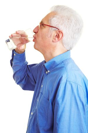 year profile: Male senior citizen in blue shirt drinking mineral water