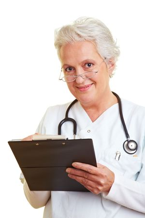 A senior female doctor holding a clipboard photo