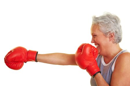 Happy senior woman with red boxing gloves Stock Photo - 6398061