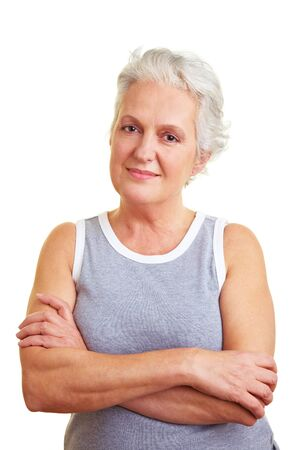Happy senior woman with her arms crossed photo
