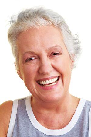 Happy senior woman smiling into the camera photo