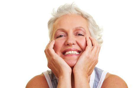 denture: Happy senior woman smiling into the camera Stock Photo