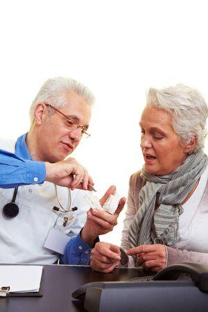 Dentist explaining dental prints to his patient Stock Photo - 6398062