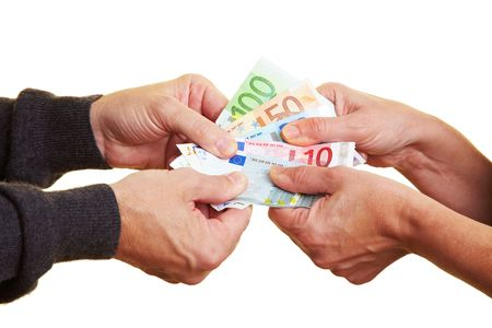 pulling money: Four hands pulling hard on Euro banknotes Stock Photo