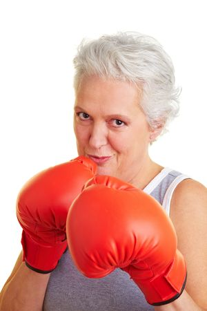 Happy senior woman with red boxing gloves photo